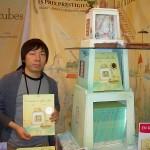 Kunio-Katō-Holding-A-Copy-Of-La-Maison-En-Petits-Cubes-Audiopolitan